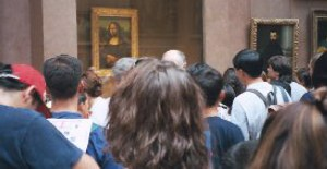 Mona Lisa with people crowding around